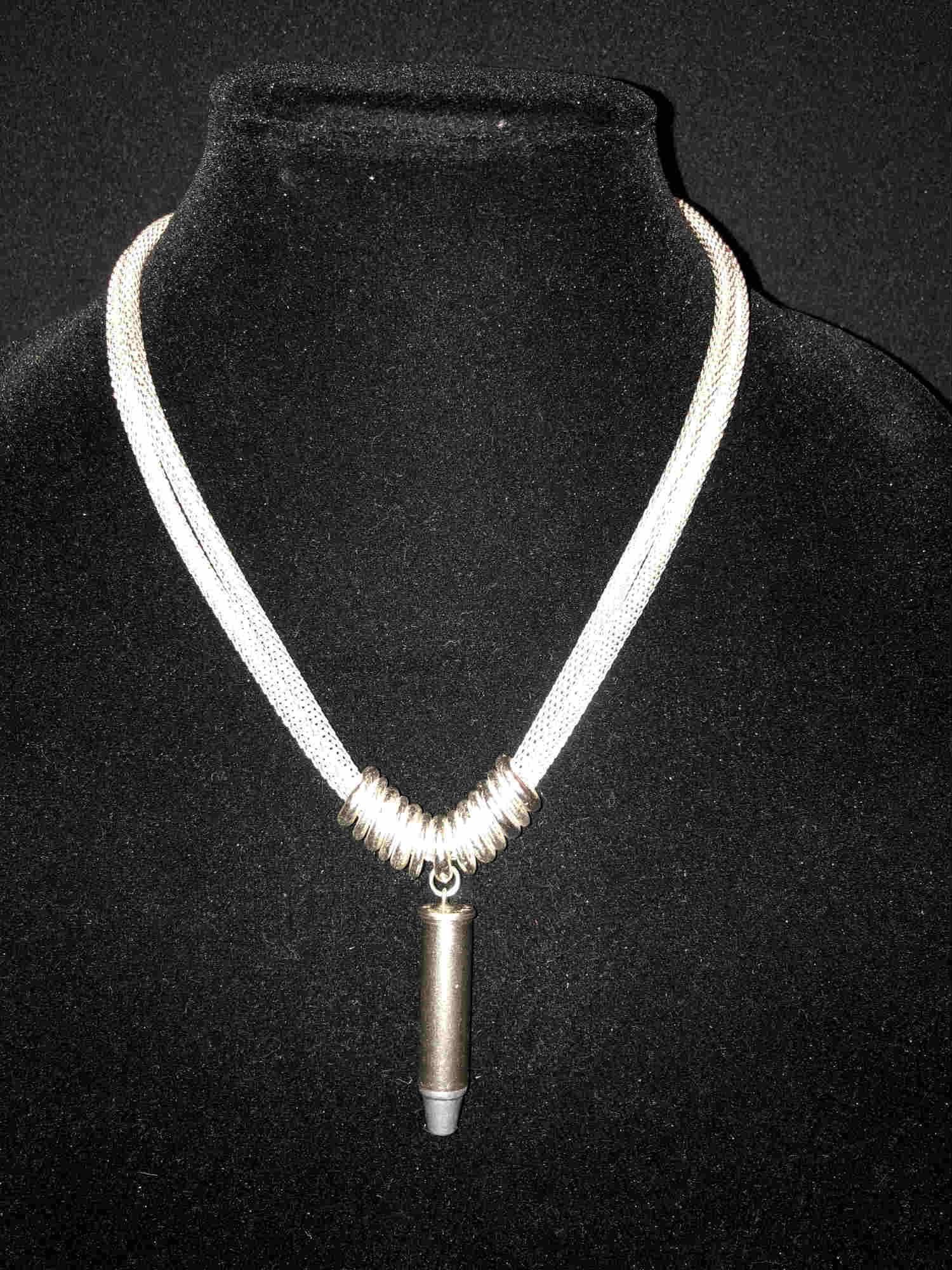 Circle 13 Two mesh chains adorned with 13 stainless rings and .357 caliber nickle bullet. 18 inch adjustable length.