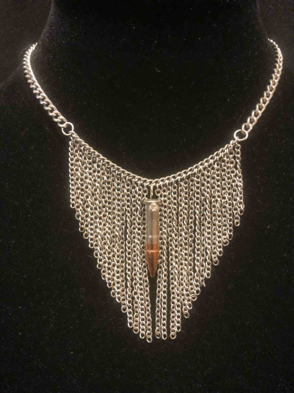 North Star .233 copper tip in a .22 caliber nickel bullet-custom combination! A single rhinestone suspends this bullet on 16 -18 inch adj stainless chain with a background of fringe.